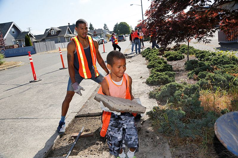 Volunteers of all ages help with our Depave program